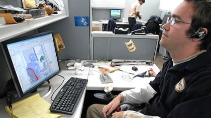 Computer simulation Research assistant Joseph Olson runs through a computer simulation of the task movements a wheelchair with a robotic arm must perform to open a refrigerator, select a drink container and open it.