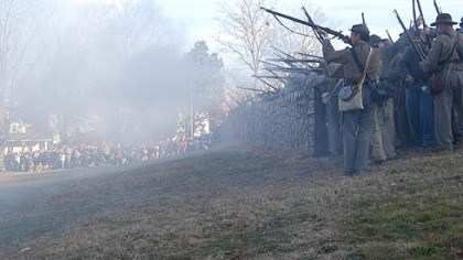 Confederate rifles Confederate rifle men fire from behind a replica of the stone wall at the base of Marye's Heights, where the worst of the fighting occurred Dec 13, 1862, during the Battle of Fredericksburg, Va.
