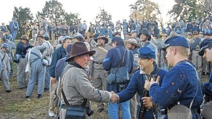 Confederate, Union re-enactors Confederate and Union soldiers shake hands after the 150th anniversary re-enactment of the Battle of Fredericksburg on Dec. 8, 2012.
