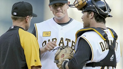 Conference on the mound Pirates pitching coach Jeff Andrews and Ryan Doumit talk with Pirates pitcher Jimmy Barthmaier in the first inning against the Rays Friday night.