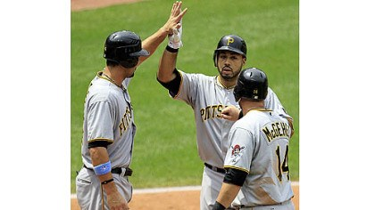 Congratulations The Pirates' Pedro Alvarez, center, is congratulated by teammates Garrett Jones, left, and Casey McGehee after hitting a three-run home run off Cleveland Indians starting pitcher Jeanmar Gomez in the fourth inning.