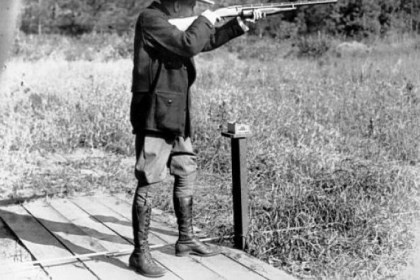 cool President Calvin Coolidge, a straight shooter, hit 29 of 37 clay pigeons during this outing at his vacation home in Wisconsin.
