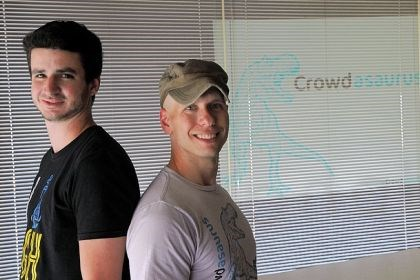 Crowdasaurus Crowdasaurus founder Josh Lucas, right, with user interface designer Kevin Miller at their office on the South Side. The company links a startup's crowdfunding campaign with regional organizations and businesses whose audiences would embrace the idea.