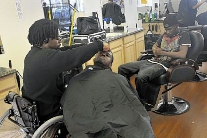 Cut 1 Francis Anim, of Crafton, right, waited for his friend, Adenan Ibrahim, to get his hair cut by Paul Perminter in the Barber School of Pittsburgh on Steuben Street in the West End.