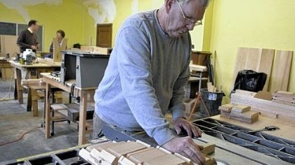 Cutting the wood At First Presbyterian Church in New Brighton, Richard Bischoff cuts pieces for tables made at the church.