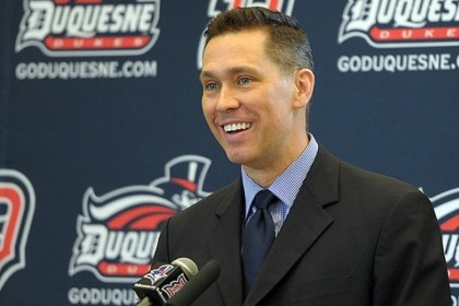 Daily0430j.jpg Duquesne University's Dan Burt talks at a press conference after being introduced as the new women's basketball coach Monday.
