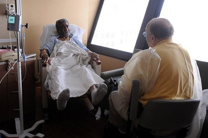 Daily0430L.jpg Jack Silverstein, of Monroeville talks with recent transplant patient Eugene Rodgers of the Hill District while visiting Allegheny General Hospital. Mr. Rodgers received a new heart and kidney in April.