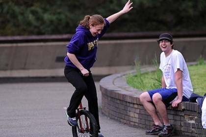 Daily0430m.jpg Chelsea Herrity, left, a 21-year-old Pitt student takes her second lesson learning to ride a unicycle near ice skating rink in Schenley Park. Ryan Jakubek, 22, also a Pitt student, right, bought the cycles off the Internet.
