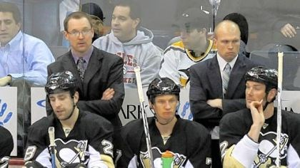 Dan Bylsma New Penguins interim coach Dan Bylsma stands next to assistant coach Mike Yeo in Thursday night's win over Montreal. The Penguins face two critical games this weekend.