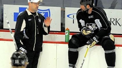 Dan Bylsma and Bill Guerin Penguins head coach Dan Bylsma (left) talks with forward Bill Guerin during practice at the Mellon Arena for their Stanley Cup Finals Game 1 with the Detroit Red Wings tomorrow.