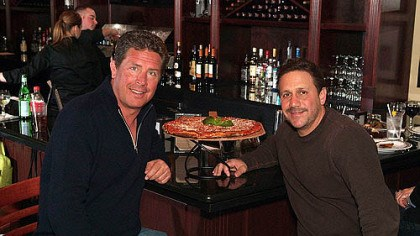 Dan Marino and Anthony Bruno Dan Marino, left, and Anthony Bruno of Anthony's Coal Fired Pizza. Mr. Marino is one of the equity partners in a Florida-based restaurant group, which is set to open its first Pittsburgh-area location in Robinson on Saturday.
