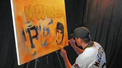 Daniel McCutchen Pirates pitcher Daniel McCutchen autographs his painting Friday in Bradenton, Fla., that will be auctioned off for Pirate Charities.