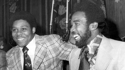 Dapper Dan dining Caught in a light moment during the Dapper Dan Club festivities in this 1975 photo were the Steelers' Dwight White, left, and the Pirates' Manny Sanguillen.