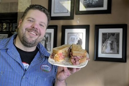 Darren Smith Hoya (grilled corned beef) at Szmidt's Old World Deli in Greenfield, held by owner Darren Smith.
