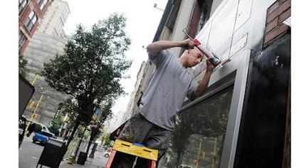 Dave Nemes Dave Nemes, from Nemes Glass Corp., caulks windows Thursday next to the Penn Garrison. Construction and renovation projects are springing up all across the 800 and 900 blocks of Penn Avenue, Downtown.