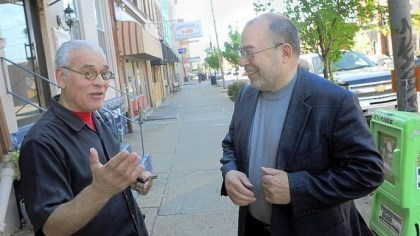 David Feehan While on a walk down Liberty Avenue in Bloomfield, David Feehan, right, stops to talk with businessman Orrie Mariani.