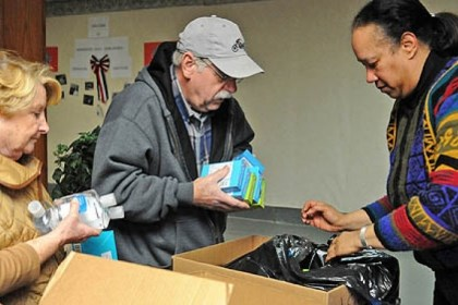 Day of Service Ruth and Bob Sasser, left, from Upper St. Clair and Marva Williams from Penn Hills assemble care packages for military families in Pittsburgh at the Homewood AME Zion church in Homewood as part of the National Day of Service in honor of Rev. Martin Luther King, Jr.