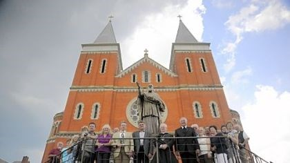 Delegation In this photo from 2009, a delegation from Thalmasing, Germany, Boniface Wimmer's hometown, poses for a portrait in front of St. Vincent Basilica.