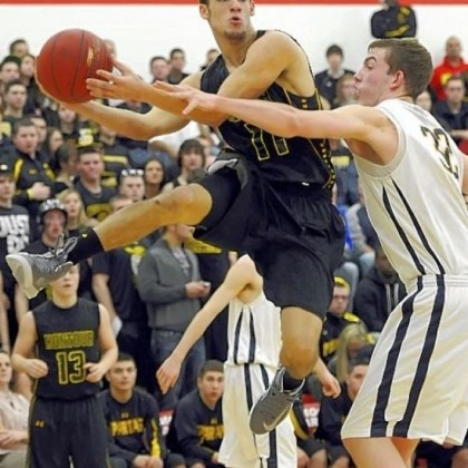 DevinWilson Montour's Devin Wilson, left, looks to slide a pass around Mars' Josh Goetz in a Class AAA semifinal Tuesday at Moon.