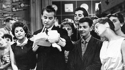 "Dick Clark on 'American Bandstand' Dick Clark is surrounded by fans during a 1957 television broadcast of ""American Bandstand."""