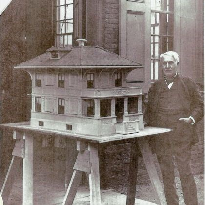 Donora_5 Thomas Edison poses in 1911 with a prototype concrete-cast model house designed in an ornate French-Renaissance style.