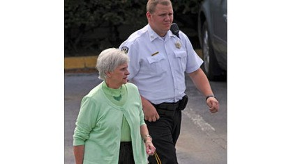 dottie leaves day 6 Dottie Sandusky leaves the Centre County Courthouse after testifying on behalf of her husband, Jerry, during his trial Tuesday afternoon.