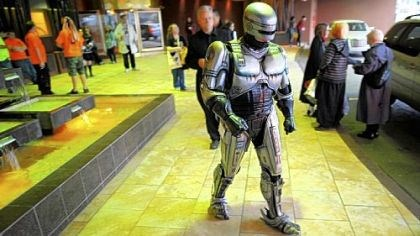 Dressed as Robocop, Joe Miner of Philippi, W.Va., Dressed as Robocop, Joe Miner of Philippi, W.Va., walks outside the Wyndham Grand during Tekkoshocon, an annual anime and otaku culture convention Thursday.