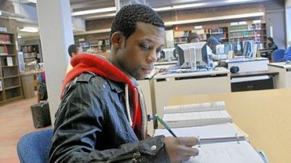 Drew Peters To help remember what was taught, Community College of Allegheny County freshman Drew Peters reviews his class materials immediately after class in the school library on the Allegheny campus.