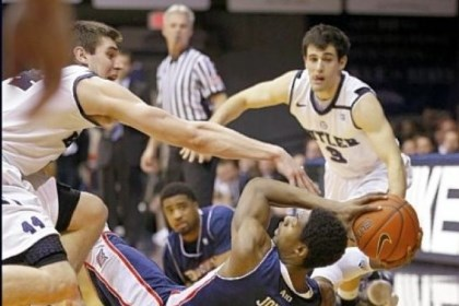 dukes1 Butler's Andrew Smith, left, and Alex Barlow swarm around Duquesne's Jerry Jones in the first half Tuesday night in Indianapolis.