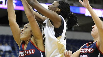 Duquesne vs. Pitt Duquesne player Samantha Pollino (30) battles for a rebound against Pitt's Chelsea Cole (22).