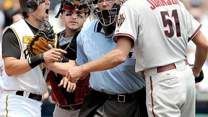 Dust up Doug Mientkiewicz, left, and Diamondbacks starter Randy Johnson are restrained by umpire Jeff Kellogg and Arizona catcher Miguel Montero in the third inning yesterday at PNC Park.