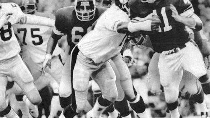 Dwight White in action Steeler Dwight White stops Vikings' the Dave Osborn in a game during the 1970s.