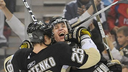 Early in the game Evgeni Malkin and Petr Sykora congratulate Ruslan Fedotenko on his first-period goal against the Sabres last night.