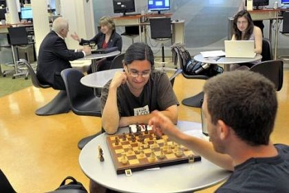 ed tab med students Mike Huijon, left, and Ben Israel, right, take time out for a game of chess in the Carnegie Library cafe in 2012. Both are medical students studying psychiatry at the University of Pittsburgh and had a break from classes.