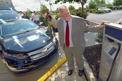 electric1 Rick Price, executive director of the nonprofit Pittsburgh Regional Clean Cities, watches an electric vehicle being charged at Consol Energy's new charging station at its Southpointe headquarters building.