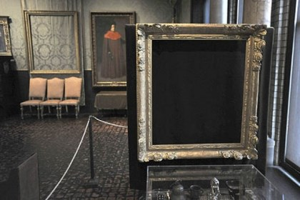 "Empty frames Empty frames from which thieves took ""Storm on the Sea of Galilee,"" left background, by Rembrandt and ""The Concert,"" right foreground, by Vermeer 23 years ago, remain on display at the Isabella Stewart Gardner Museum in Boston."