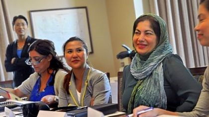 entrepreneurship training session Farah Ibrahim Albastaki, second from right, listens to the welcoming greeting at the entrepreneurship training session at Chatham University Monday. To her right is Bernadette Cruz Herrera-Dy of the Philippines.