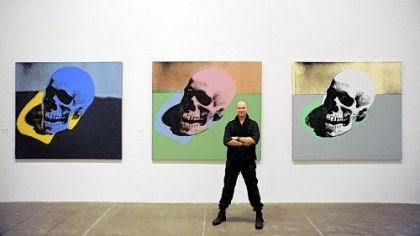 "Eric Shiner and ""Skulls"" New Castle native Eric Shiner, the first Milton Fine Curator of Art at The Andy Warhol Museum, stands in front of Warhol's ""Skulls"" at the museum."