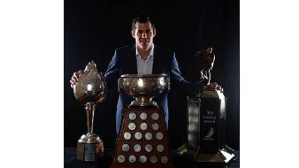 Evgeni Malkin Evgeni Malkin of the Penguins poses Wednesday after winning the Hart Trophy, the Art Ross Trophy and the Ted Lindsay Award during the 2012 NHL Awards at the Encore Theater at the Wynn Las Vegas.