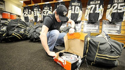 Evgeni Malkin packing his bags As much as everyone might want this season to go on, the bottom line is it ended Wednesday night. Now it's time to go home for the summer, driven home by players such as Evgeni Malkin packing his bags in the Penguins' locker room Friday.