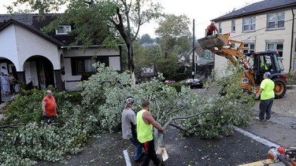 Fallen tree In Dormont, a crew clears a fallen tree on Voelkel Avenue at La Salle Avenue.