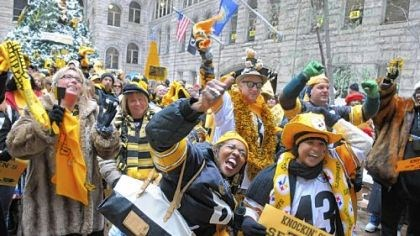 Fans cheer Fans cheer during the Steelers Rally held Friday at the Allegheny County Courthouse.