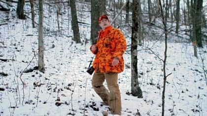 Father Mike Zavage Father Mike Zavage, 28, walks through Oak Forest, Greene County, on his first hunting trip of the season.