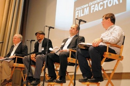 "Film Factory panelists Moderator Carl Kurlander, far left, listens as panelists Rusty Cundieff, Asher Garfinkel and Doug Crise critique movie pitches Saturday at the fourth annual Film Factory ""Writer's Pitch."""