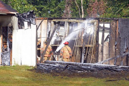 Fire at Cool Springs Firefighters douse the hotspots on part of the Cool Springs Golf Center.