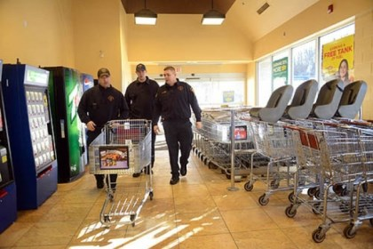 firefighters shopping From left, firefighters Kevin Murphy and Dan Reiser and Lt. John Gardell enter a Giant Eagle to buy items for the day's meals. Three minutes into shopping, the three receive a call for sparking wires near a residence and leave the store.