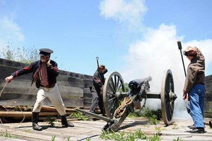 Firing cannon Members of Carpenter's Battery, a Confederate artillery unit, fire a 3-inch ordnance rifle at Old Bedford Village during a re-enactment in June. From left: Don Griffey of Moon, Val Shuppe of Saltsburg and her daughter, Yvonne.