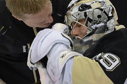 fleury hurt Penguins' athletic trainer Chris Stewart examines goalie Marc-Andre Fleury after a collision with the Canadiens Tomas Plekanec Tuesday night.