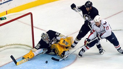 Fleury save Penguins goalie Marc-Andre Fleury, left, makes a save on a shot by Washington Capitals' Chris Clark (17) as Penguins' Ryan Whitney looks on during the third period last night.