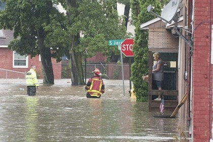 flood mess in Dubois Firefighters looked for stranded residents along South Jared Street in DuBois on Thursday.